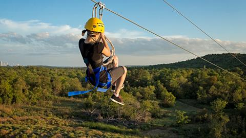 Young woman riding a Zipline Canopy Tour