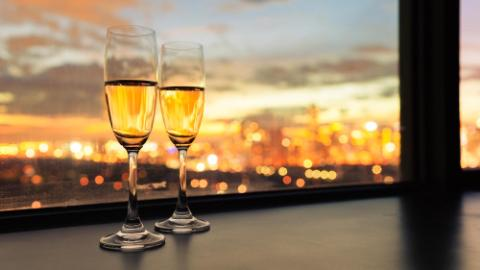 two champagne glasses and beautiful city views
